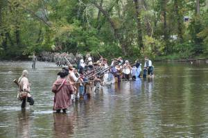 The militia, members of the OVTA and the Tennessee National Guard crossing the river